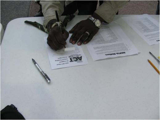 Rider at a table filling out a sign-up form